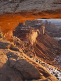 Landscape Through Mesa Arch at Sunrise, Canyonlands National Park, Moab, Utah, USA