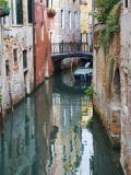 Reflections and Small Bridge of Canal of Venice, Italy