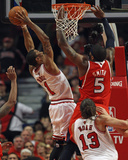 Atlanta Hawks v Chicago Bulls - Game Five, Chicago, IL - MAY 10: Derrick Rose and Josh Smith Photographic Print