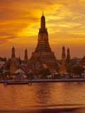 Thailand, Bangkok, Wat Arun ,Temple of the Dawn and Chao Phraya River Illuminated at Sunset