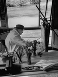 Winston Churchill Sitting at His Easel Painting