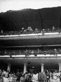 Britain's Prime Minister Winston Churchill and His Wife Waving to a Crowd from the Grandstand