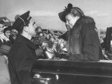 Naval Officer Helping Eleanor Roosevelt Out of Convertible