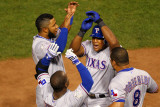 Rangers v Cardinals - Oct. 27: Adrian Beltre, Esteban German, Yorvit Torrealba and Elvis Andrus