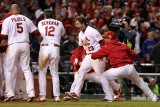 Rangers v Cardinals, St Louis, MO - Oct. 27: David Freese, Albert Pujols and Lance Berkman
