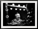 Charlie Chaplin at Dressing Room Mirror, Giving Himself a Wide Grin