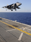 An AV-8B Harrier Jet Prepares to Land on the Flight Deck of USS Essex