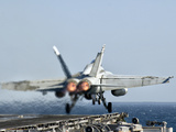 A F/A-18F Super Hornet Launches from the Flight Deck of Aircraft Carrier USS Nimitz