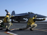Shooters Aboard the USS George H.W. Bush Give the Go-Ahead Signal to Launch an F/A-18 Super Hornet