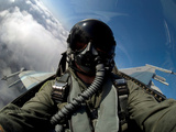 A Pilot in the Cockpit of an F-16 Fighting Falcon