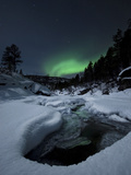 Aurora Borealis over Tennevik River in Norway