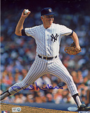 Phil Niekro Autographed Yankees Pinstripe Uniform Pitching Vertical Photograph