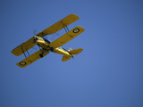 A De Havilland Dh-82A Tiger Moth 1930S Biplane Soars High in the Sky