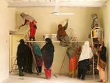 Women Paint a School Room in Jalalabad, Afghanistan