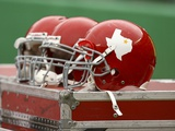 Cowboys Chiefs Football: Kansas City, MO - Chiefs Throwback Helmets