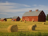 Barns and Hay Bales in Field