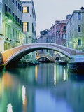 Bridge above a channel in Venice, evening shot