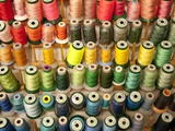 Multi-colored thread in high school sewing class Photographic Print