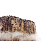 Sheer cliff rising above clouds
