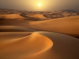 Intense Sun over sand dunes around Dubai