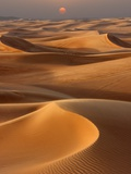 Sunset over the sand dunes in Dubai Photographic Print