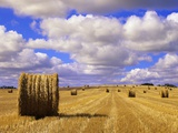 Bales and Clouds Near Sherbrooke, Saskatchewan, Canada.