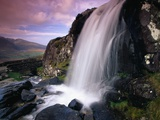 Waterfall and Jagged Rocks in the Irish Countryside