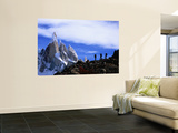 Hikers on a Ridge Dwarfed by Cerro Torre Laminated Oversized Art