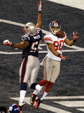 New York Giants and New England Patriots - Super Bowl XLVI - February 5, 2012: Jerod Mayo and Victo,