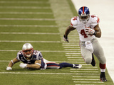 New York Giants and New England Patriots - Super Bowl XLVI - February 5, 2012: Ahmad Bradshaw and P