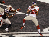 New York Giants and New England Patriots - Super Bowl XLVI - February 5, 2012: Victor Cruz,
