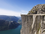 Man Standing on Preikestolen (Pulpit Rock) Above Fjord, Lysefjord, Norway, Scandinavia, Europe