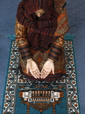 Muslim Woman Kneeling on Prayer Mat Saying Prayers, Jordan, Middle East