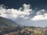 Village of Shingyer Against a Dramatic Backdrop of Mountains and Clouds, Phobjikha Valley, Bhutan,