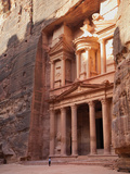 Tourist Looking Up at the Facade of the Treasury (Al Khazneh) Carved into the Red Rock at Petra, UN