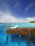 Sun Lounger and Jetty in Blue Lagoon on Tropical Island, Maldives, Indian Ocean, Asia