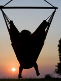 Malawi, Lake Malawi National Park, Young Guest Relaxes in a Hammock at Pumulani Lodge, (MR)