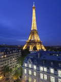 France, Paris, Eiffel Tower, Viewed over Rooftops at Night