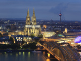 Germany, North Rhine Westphalia, Cologne (Koln), Hohenzoller Bridge over River Rhine and Cathedral