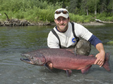 Fly Fisherman with a King Salmon (Oncorhynchus Tshawytscha), Red Creek, Alaska, USA