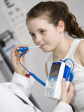 Pediatrician Examining a Girl and Taking Her Temperature