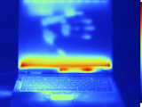 Thermogram of a Laptop Computer with a Thermal Shadow of a Hand on its Screen