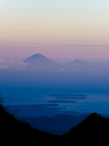 Sunset over Mount Agung and Mount Batur on Bali, and Three Gili Isles, Lombok, Indonesia