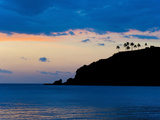 Silhouette of Palm Trees on a Cliff at Sunset, Nippah Beach, Lombok, Indonesia, Southeast Asia