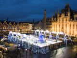 Ice Rink and Christmas Market in the Market Square, Bruges, West Vlaanderen (Flanders), Belgium