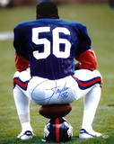 Lawrence Taylor Sitting on Football and Helmet Autographed Photo (Hand Signed Collectable)
