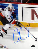 Adrian Aucoin with Puck Autographed Photo (Hand Signed Collectable)