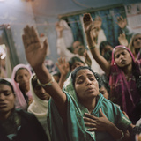 Christian worshippers gather in a pastor's home in Orissa.