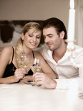 Young Couple Clinking Glasses of White Wine