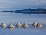 Salt Pyramids Wait for the Sun in a Flooded Salf Flat in Uyuni,